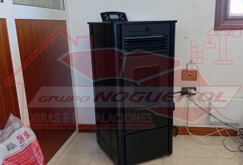 Instalación estufa de pellets para oficinas en Melide